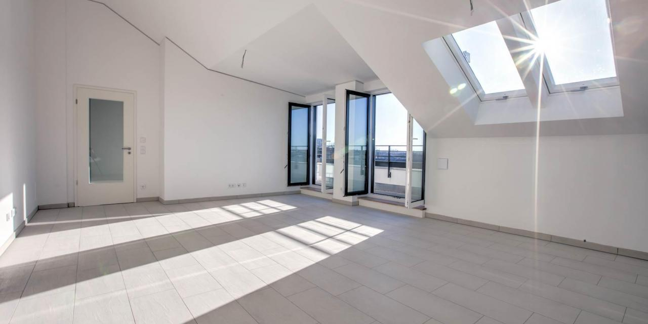Erstbezug: Exklusive DG-Wohnung mit tollem Blick