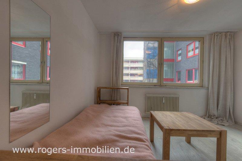 München Schwabing Immobilienmakler Wohnung verkaufen Blick ins Zimmer